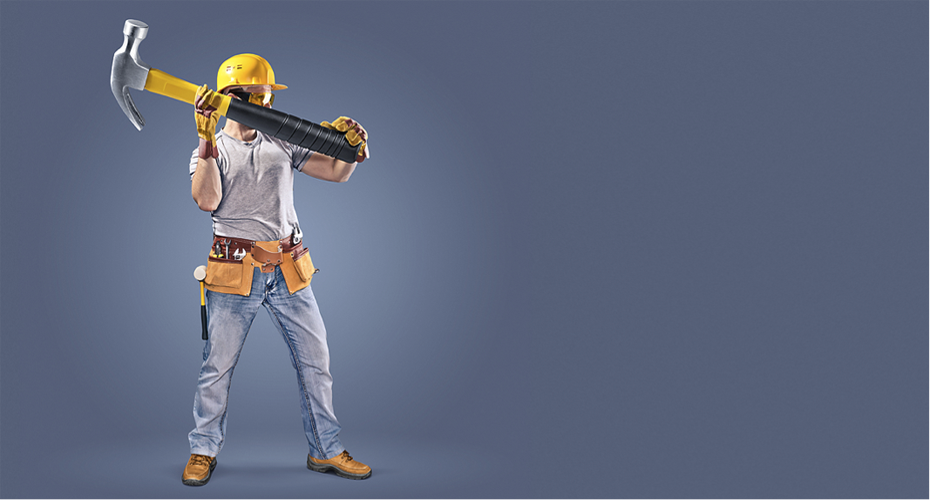 Tradesman holding a large hammer